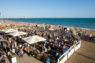 Crowded bars and beach on hot summer day, Brighton, East Sussex, United Kingdom