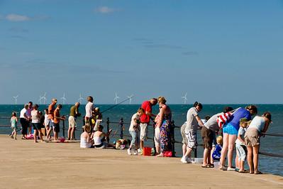 People fishing from Hampton Pier, Herne Bay, Kent, United Kingdom