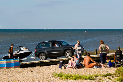 People relaxing on the beach, Whitstable, Kent, United Kingdom
