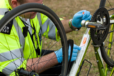 Police officers are security tagging bicycles as antitheft measure during Mayor of London's Sky Ride Ealing 2010 event, United Kingdom