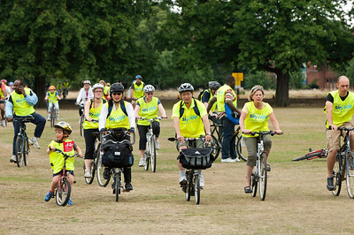 People cycle across Ealing Common during Mayor of London's Sky Ride Ealing 2010 event, United Kingdom
