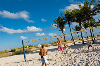 Young people playing beach volleyball, South Beach, Miami, USA