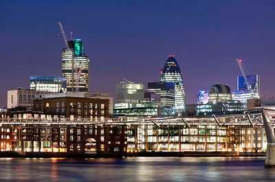City of London and office buildings by Thames River illuminated at night, London, United Kingdom
