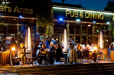 People drinking alfresco at pub in the evening, London, United Kingdom