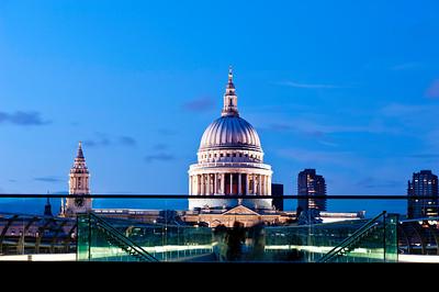 St Pauls Cathedral and Millenium Bridge illuminated at night London, United Kingdom