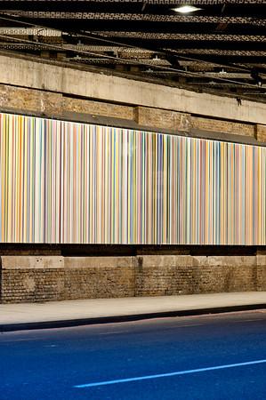 Southwark, Paul Smith stripe artwork under a railway bridge in Southwark Street, London, United Kingdom