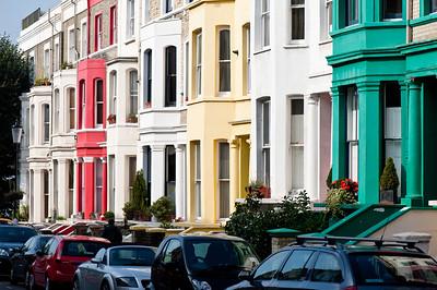 Colourful facades of houses in Ladbroke Grove area, W11, London, United Kingdom