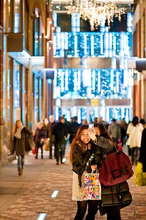 Two Asian female tourists taking photos, Christmas season 2010, Slingsby Place, WC2,  London, United Kingdom