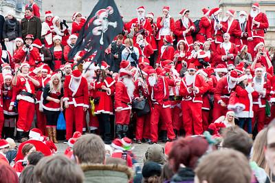 Hundreds of Santas meet in Trafalgar Square, organised via Twitter and Facebook, Christmas season 2010, London, United Kingdom