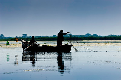 Europe, Romania, The Danube Delta, Lake Uzlina , fishermen setting nets to catch fish, most of local fishermen are Lipovani - descendants of Old Believers, who left Russia in 1772 to avoid religious persecution