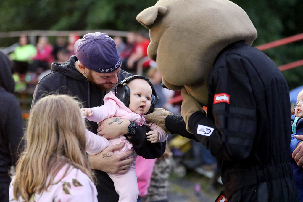 . Jonathan Tressler - The News-Herald. A young race fan gets aquainted with a mascot at The Painesville Speedway during the venue�s grand opening Sept. 2.