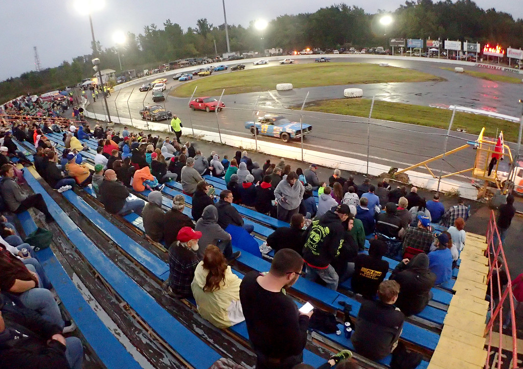 . Jonathan Tressler - The news-Herald. A view from the stands Sept. 2 during the grand opening of The Painesville Speedway. Although the race was called due to rain, fans got a little taste of race-track action as the cars did laps in an attempt to dry the asphalt.