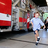 Jonathan Tressler — The News-Herald <br> 6-year-old Matteo Carini, who was born with Down syndrome, skips for joy inside Mentor Fire Station No. 5 Sept. 1 during a special surprise party Mentor firefighters threw for him.