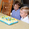 Jonathan Tressler — The News-Herald <br> Matteo Carini, 6, left, and his brother Luca, 4, are all smiles as Matteo gears up to blow out the candles on his birthday cake the Mentor Fire Department had waiting as part of Matteo's surprise sixth birthday party at Fire Station No. 5. Matteo, who was born with Down syndrome and battles other physical challenges, loves fire trucks and all things fire service, according to his mom, Angela Carini.