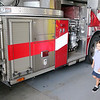 Jonathan Tressler — The News-Herald <br> Matteo Carini, 6, seems to be in 7th heaven, checking out the fire apparatus inside Mentor Fire Station No. 5, where fire personnel threw him a surprise birtthday party after learning he was upset over his father's absence on  his Aug. 28 birthday. Matteo was born with Down syndrome and battles other physical challenges and loves fire engines, his mom, Angela, said.