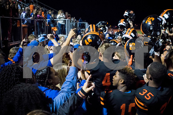 Sam Buckner for Shaw Media.<br /> Dekalb students sing the fight song along with the football team after beating Carmel on Friday September 1, 2017.
