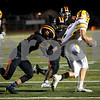 Sam Buckner for Shaw Media.<br /> Jarrett Sykes grabs a hold of Stephen Gracia of Carmel while Tyrese Dyson comes in to assist the tackle on Friday September 1, 2017.