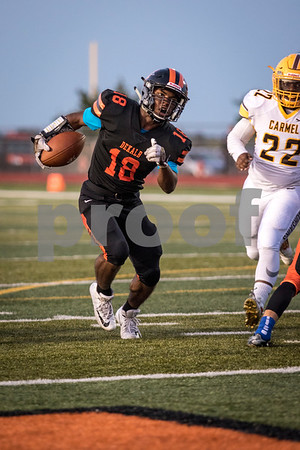 Sam Buckner for Shaw Media.<br /> Tyrese Dyson runs the ball on Friday September 1, 2017 in a game against Carmel.