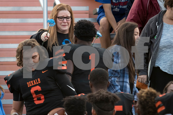 Sam Buckner for Shaw Media.<br /> Brenda Shakir wife of the late Ata Shakir, hugs Dekalb football players as they give her a blue flower one by one on Friday Sepember 1, 2017. Ata Shakir, was a teacher at Dekalb High School who died of colon cancer this morning.