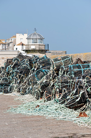 Lobster pots drying in the harbour, St Ives, Cornwall, United Kingdom