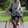 DeKalb resident Tammy Sutphin sets off on the Hike and Bike for the Trail event after registering at Hopkins Park on Monday morning.The Dekalb Rotary sponsored event raised funds for restoration of the DeKalb Nature Trail.  Steve Bittinger - For Shaw Media