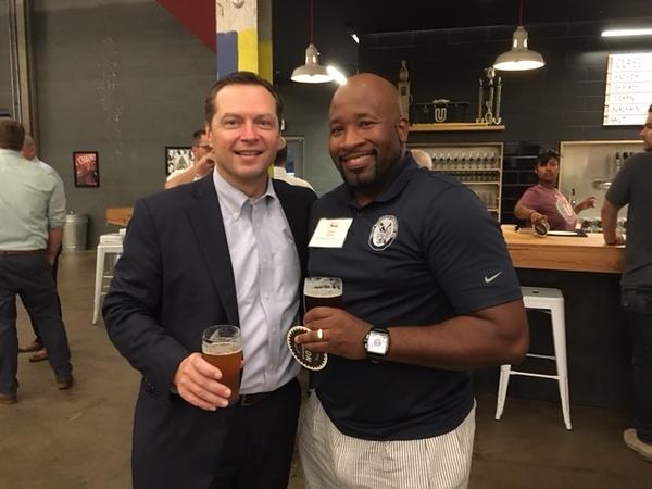 Board members enjoying a beer