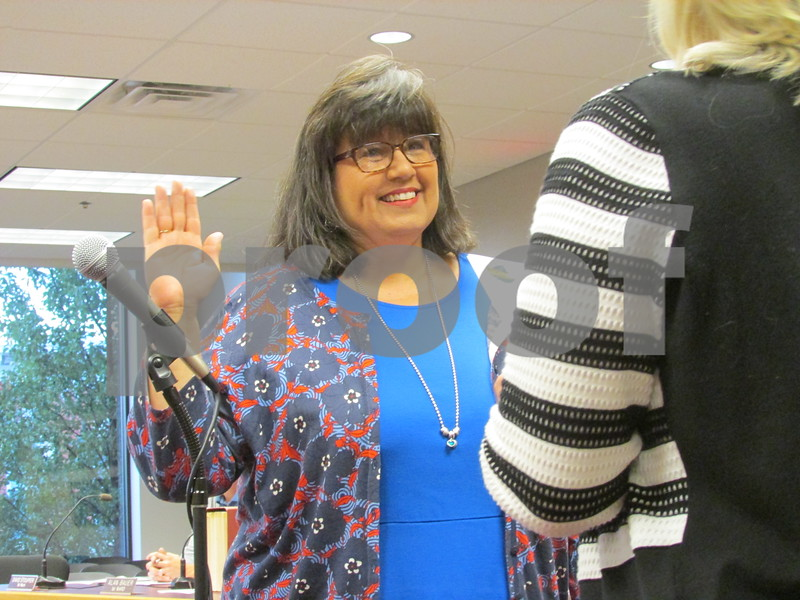 DREW ZIMMERMAN – dzimmerman@shawmedia.com<br /> Nancy Copple is sworn in as the Sycamore City Council's newest alderwoman during Tuesday's meeting. She replaces Becky Springer, who resigned after moving outside of her ward.