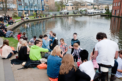 People relaxing by Camden Lock, Camden, NW1, London, United Kingdom