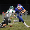 Brett Marth carries the ball for Genoa-Kingston on Friday night.  Steve Bittinger - For Shaw Media