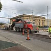 Richard Payerchin — The Morning Journal <br> Workers from Chagrin Valley Paving Inc. and its subcontractors work on scraping the top layer of pavement from Broadway on Sept. 8, 2017. The section of Broadway from West Erie Avenue to 10th Street will be resurfaced as part of the U.S. 6 paving project overseen by the Ohio Department of Transportation.