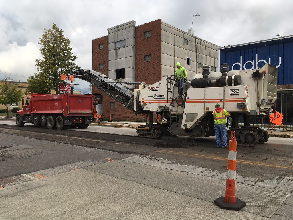 . Richard Payerchin � The Morning Journal <br> Workers from Chagrin Valley Paving Inc. and its subcontractors work on scraping the top layer of pavement from Broadway on Sept. 8, 2017. The section of Broadway from West Erie Avenue to 10th Street will be resurfaced as part of the U.S. 6 paving project overseen by the Ohio Department of Transportation.