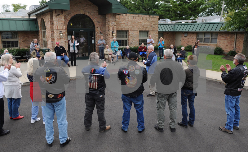 A motorcycle motorcade stops at Pine Acres Rehab and Living Center to honor veterans residing at the facility. The 11th Annual Veterans Weekend tour visited various locations in the DeKalb/Sycamore area on Saturday.  Steve Bittinger - For Shaw Media