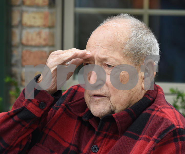 Korean War veteran John Dlabal Jr. salutes the flag during a ceremony at Pine Acres Rehab and Living Center on Saturday. Steve Bittinger - For Shaw Media