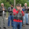 The 11th Annual Veterans Weekend organizer Frank Beierlotzer leads the applause for resident veterans at Pine Acres Rehab and Living Center  on Saturday in DeKalb.  Steve Bittinger - For Shaw Media