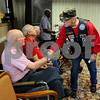 The 11th Annual Veterans Weekend organizer Frank Beierlotzer thanks veteran Warren Lowe, left, for his service on a stop at Barb City Manor on Saturday in DeKalb.  Steve Bittinger - For Shaw Media