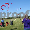 Katie Finlon for Shaw Media<br /> Sharon Overmann of Marion, Iowa, flies a kite that her husband made during DeKalb Kite Fest on Sunday on the Northern Illinois University campus in DeKalb. Sharon's husband, Jim Overmann, was one of the people who organized the inaugural festival in 2006.