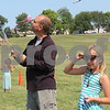 Katie Finlon for Shaw Media<br /> Tim Luetkebuenger and his 9-year-old daughter, Jenna, both of DeKalb, fly their kites Sunday during DeKalb Kite Fest on the Northern Illinois University campus in DeKalb.