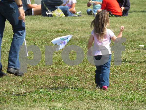 Katie Finlon for Shaw Media<br /> Kids were able to create and fly their own kites Sunday at DeKalb Kite Fest on the Northern Illinois University campus in DeKalb.