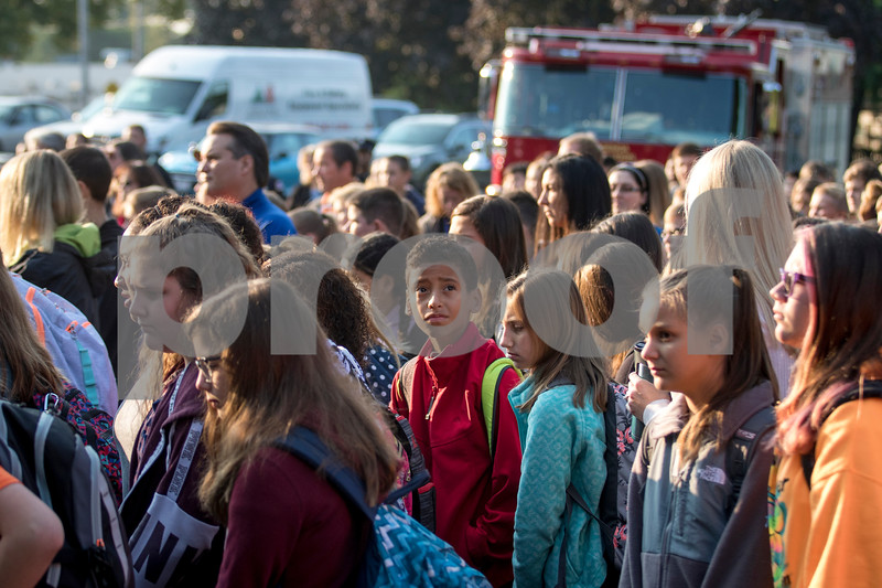 Sam Buckner for Shaw Media.<br /> A student looks up at the American flag as the school walks back to class after an early morning assembly on Monday September 11, 2017.