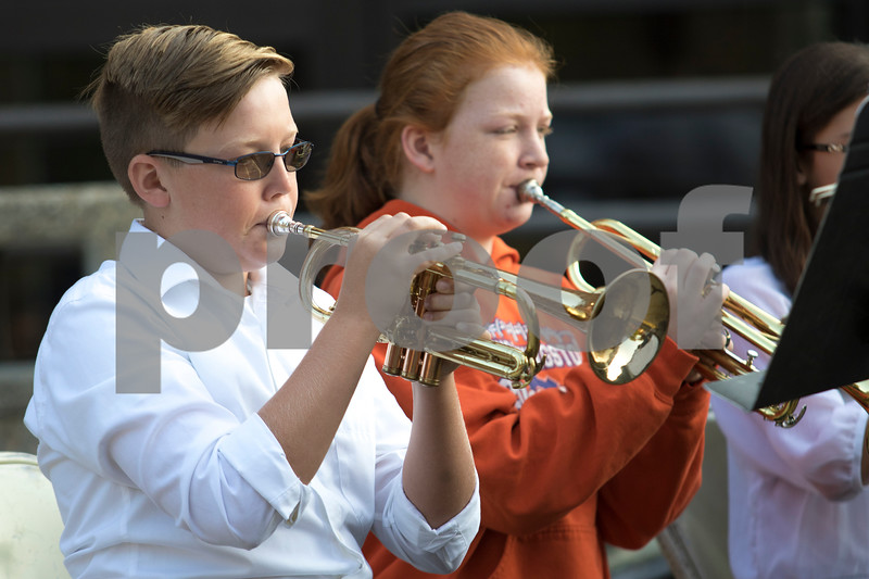 """Sam Buckner for Shaw Media.<br /> Ben Younker and McKenzie McConnell play """"America the Beautiful"""" with the Genoa-Kingston Middle School band during the 9/11 Remembrance Day assembly on Monday September 11, 2017."""