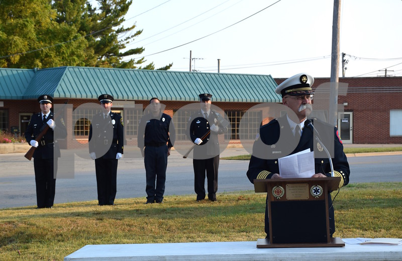 Katrina J.E. Milton - kmilton@shawmedia.com<br /> Sycamore Fire Chief Peter Polarek gives an opening address during the 9/11 memorial service held Monday by the Sycamore Fire and Police Department. Polarek said that it is difficult to put into words how 9/11 effected America, because a terrorist attack of its kind was incomprehensible.