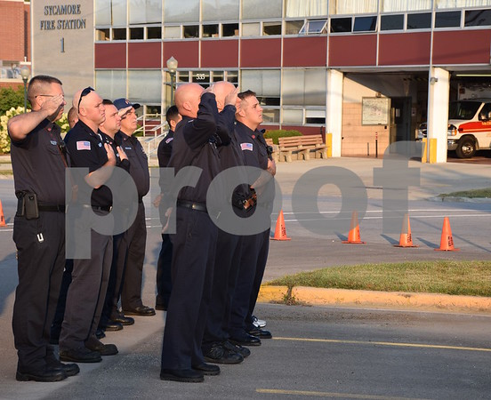 Katrina J.E. Milton - kmilton@shawmedia.com<br /> Members of the Sycamore Fire Department say the Pledge of Allegiance during the 9/11 Memorial Service held Monday by the Sycamore Fire and Police Department.