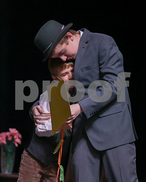 Michael Banks played by Michael Reynolds and George Banks played by Nicholas Regelbrugge embrace after finding a kit left by Mary Poppins during September 11th rehearsal.