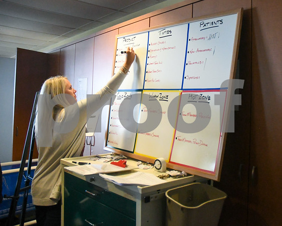 Kristen Tindall the Manager of the ER, fills out a board to help others with helpful information that could be useful during a hazard material exercise held on Sep. 12 at Kishwaukee Hospital.