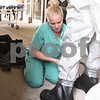 Michelle Miller helps Dominique Clement duck tape boots to her protective suit before becoming in contact with hazard material patients at a training exercise held on Sep.12 at Kishwaukee Hospital.