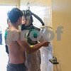NIU senior nursing student Niko Angulo gets instructions by EMT Jo Ellen Klien as he prepares to shower off the hazard material if he had come into contact with some during an exercise Sep. 12th held at Kishwaukee Hospital.
