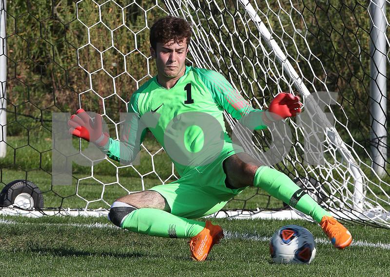 dc.sports.0914.kaneland sycamore soccer