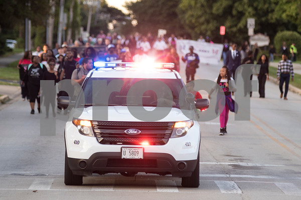 Sam Buckner for Shaw Media.<br /> NIU Police lead the 3rd annual Unity March on Wednesday September 14, 2016.