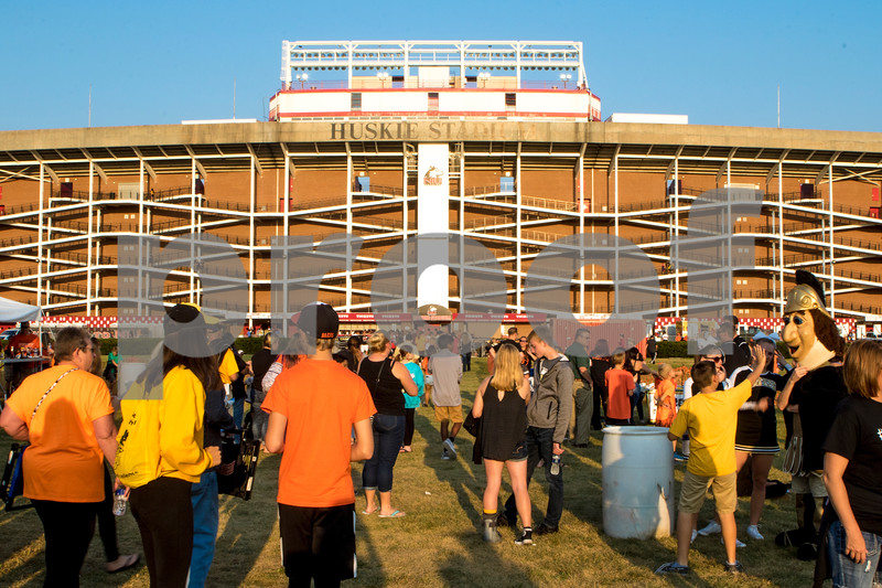 Sam Buckner for Shaw Media.<br /> Tailgaters have a good time outside the stadium before the game on Friday September 15, 2017.