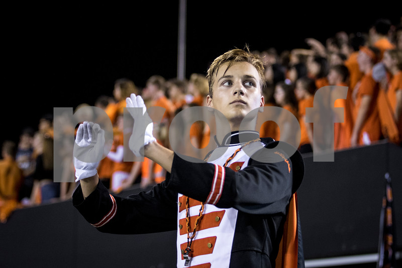 Sam Buckner for Shaw Media.<br /> Richie Spahn helps direct the marching band during the fight song before the game on Friday September 15, 2017.